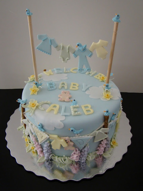 Clothesline baby shower cake. Aww, so cute. But the baby can't even ...