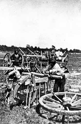 Preparing Red River ox cart at Pembina, North Dakota for trip to St. Anthony Falls, Minnesota, 1856, MHS