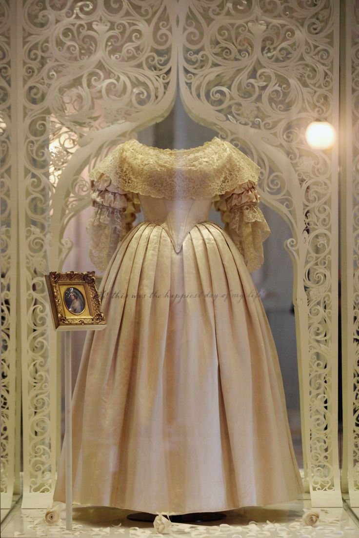 Queen Victoria married her cousin, Albert, in 1840 in this wedding gown, which is here shown in a 2012 exhibition as part of the Diamond Jubilee celebrating 60 years since the coronation of Queen Elizabeth II. The gown, of silk trimmed with lace, was designed by Mrs. Bettans, one of Victoria's dressmakers.