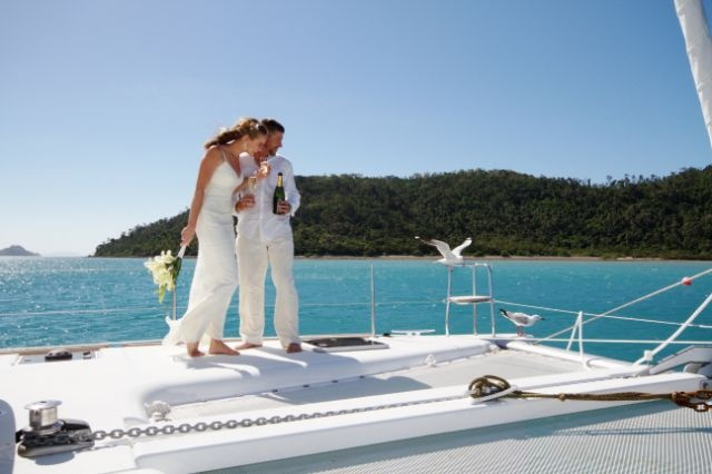 An intimate wedding on a yacht whilst cruising around the Whitsunday Islands, also a fabulous secluded honeymoon #wedding #reception #honeymoon