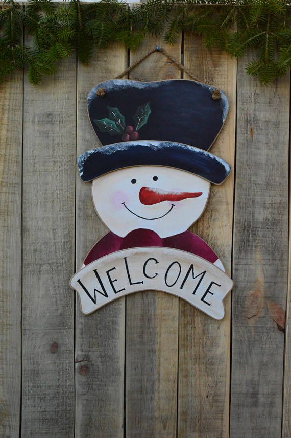 WELCOME christmas wooden sign with hand painted snowman.  An entirely handmade wooden christmas sign is here to complete your Christmas decoration. You can hange it in your living room or on your door or you can give it as a gift to a friend or a family member.  If you want this year to decorate your home with something unique, thats your chance. This handmade wooden sign is an OOAK product that you wont find anywhere else.   ❂ P R O D U C T I O N P R O C E S S ❂  The thing that makes these…