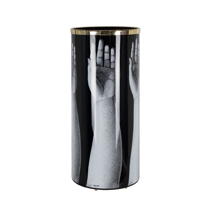 Add iconic designer style to your interior with this luxurious Mani umbrella stand from Fornasetti. Set against a stunning black background, this design features a repeating hand image in gorgeous ...