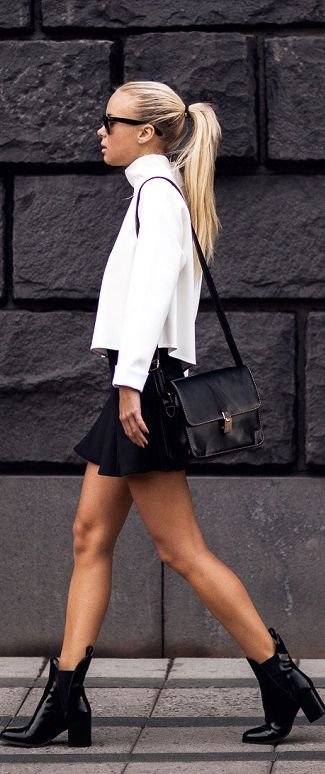 Stockholm style - Victoria Tornegren wearing white turtle neck contrasting black peplum skirt and black messanger bag  @beatrizmey