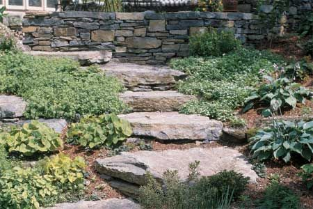 A retaining wall can hold back a hillside and turn steep slopes into living space—if you pay attention to the basics
