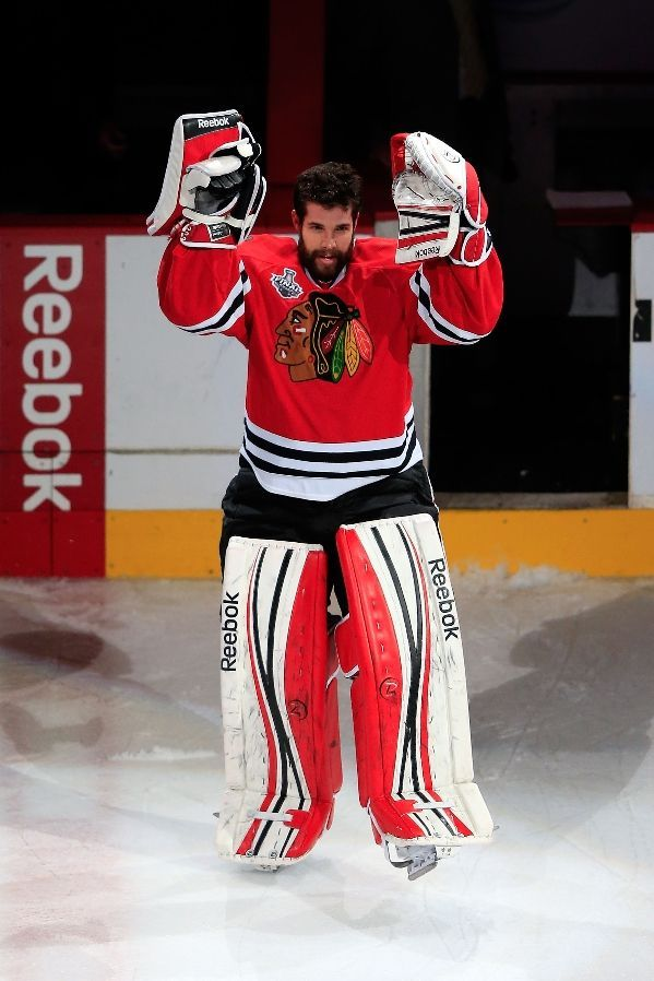 CHICAGO, IL - JUNE 22: Corey Crawford #50 of the Chicago Blackhawks waves to the crowd after defeating the Boston Bruins in Game Five of the 2013 NHL Stanley Cup Final at United Center on June 22, 2013 in Chicago, Illinois. The Chicago Blackhawks defeated the Boston Bruins 3-1. (Photo by Jamie Squire/Getty Images)