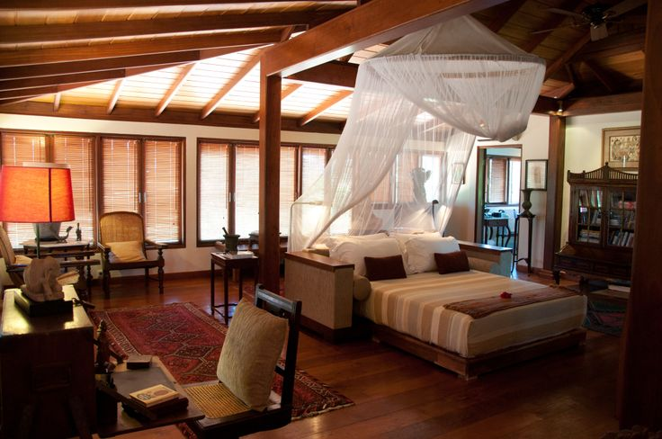 Master suite with panoramic views of the surrounding rice paddies at Villa East Indies.