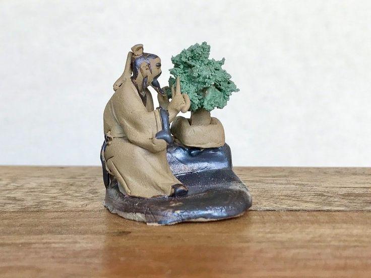 Mud man with scissor trimming tree –mudmen for bonsai trees