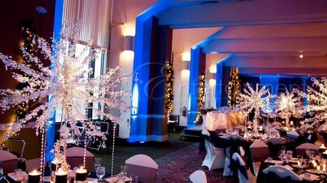 Winter Blue Uplighting by DJ Jason Rullo at Chestnut Ridge in Blairsville  Centerpieces by: Wedding Elegance by Joelle / Top Dog Productions Chair Covers by: Exquisitely Covered