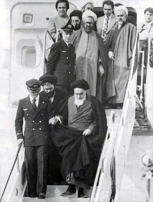 """""""Imam khomeini (ra) on his arrival from France"""" you know I've always wondering who is that guy on the left that holds Imam's hand?! :v"""