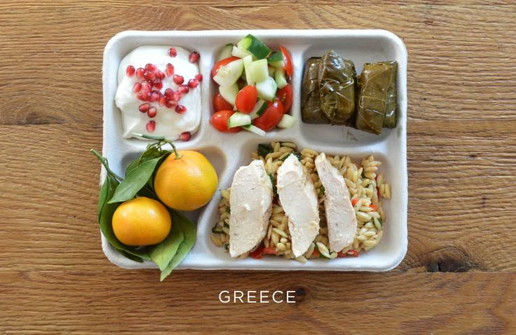 Provided by The Huffington Post School lunch from Greece - Baked chicken over orzo, stuffed grape leaves, tomato and cucumber salad, fresh oranges, and Greek yogurt with pomegranate seeds.