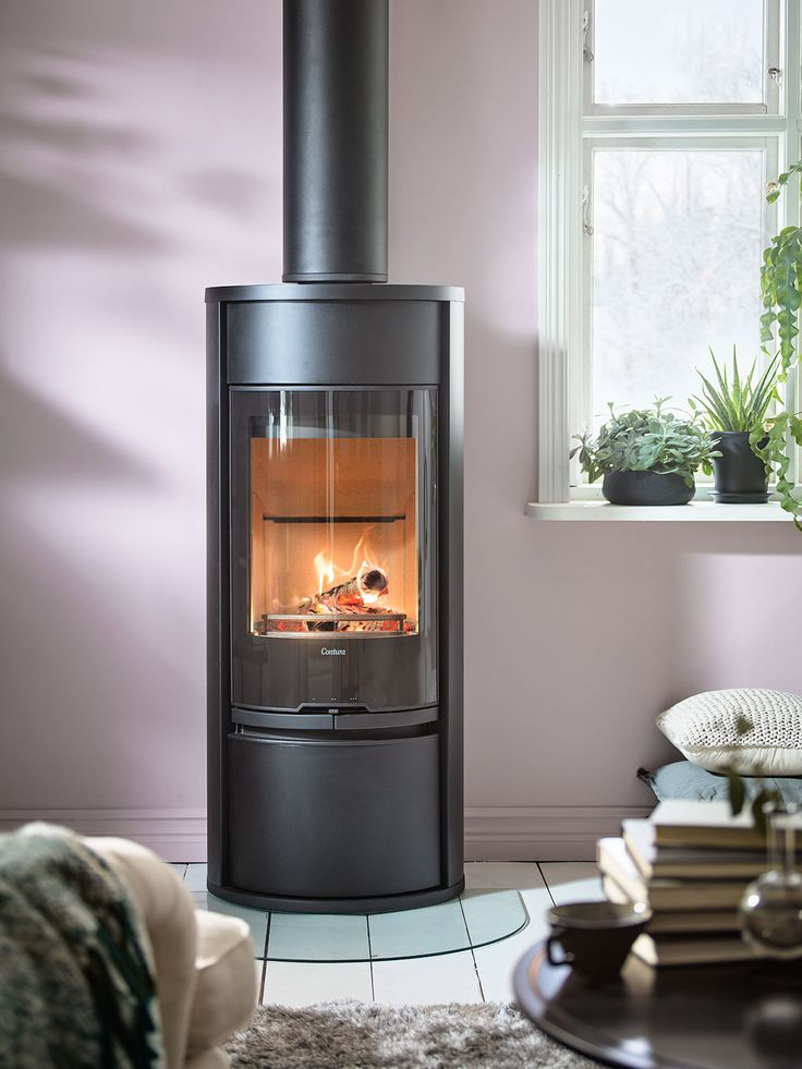 Contura 610G Style with glass door and a optional lower door. Available with powerstone, hotplate and fan.#contemporarystove #logburner #plankfloor #chimney #contura600 #conturastyle