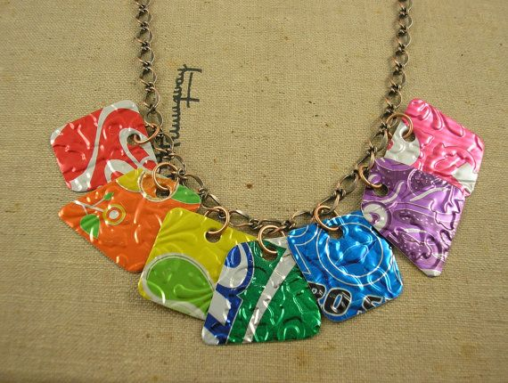 Soda Can Necklace. An etsy listing, but I think this is AWESOME! Cut colorful sections from select can sections after you have run them through your embosser.,Sand the edges VERY smooth, Attach to chain with jump rings. WOW!