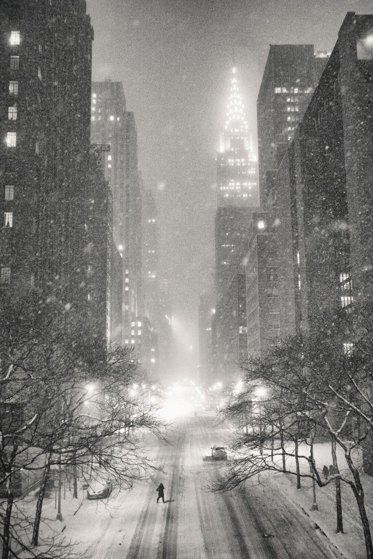 New York City on a winter night in the snow overlooking the Chrysler Building and 42nd Street in midtown Manhattan.