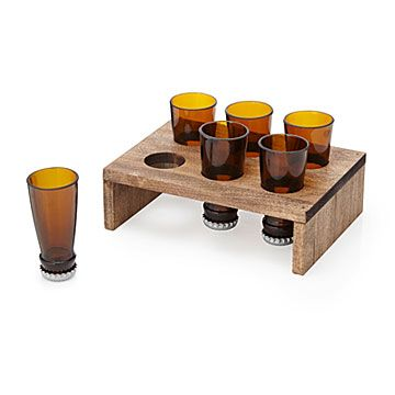 Beer Bottle Shot Glasses and Display Tray | $39.99 | A Shot and a Beer: Inspired by components of classic boilermaker, Dave Sabot turned things upside down & gave it his best shot..Set of 6 shot glasses made from repurposed beer bottles. Diamond saw-cut, ground smooth w/lapidary, capped & sealed, beer bottle necks become unique 1-oz shots. Presented in hand-finished poplar stand, set makes playful addition to your barware or gift for any shot-and-a-beer drinking buddy. Handmade in Tampa, FL.