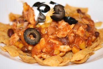 """This crockpot """"Cowboy Chow"""" recipe uses shredded chicken. It seems weird, but is REALLY good. Double it for a crowd. I serve with rice, lettuce, tomato, shredded cheese and Fritos! NO OLIVES! =)"""
