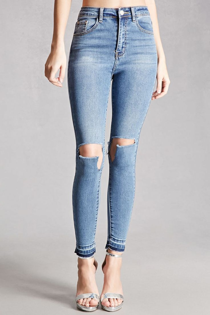 A pair of mid-rise skinny jeans by Momokrom™ featuring ripped knees, frayed hem, a faded wash and mild whiskering on the front, zip fly, and a five pocket construction.