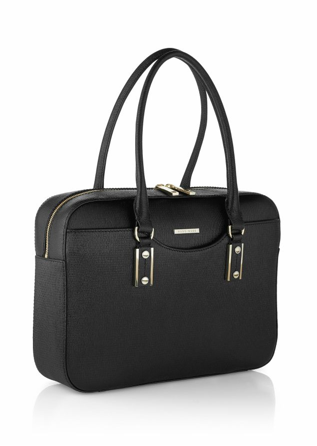 Today, Letizia showed off a new bag. This past month she has been seen carrying a men's Hugo Boss briefcase, but today she opted for the more feminine style of the Hugo Boss 'Medi-F' business bag (£430).