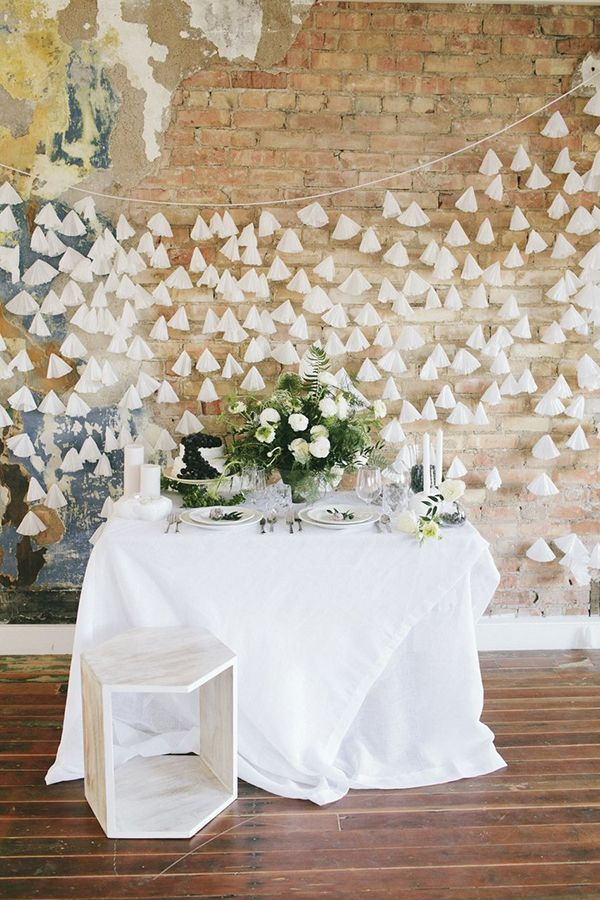 Modern organic tablescape in front of a backdrop fashioned from 500 coffee filters strung on clear fishing lines | Photo by Brooke Stapleton | Event design by Rachael Ellen Events