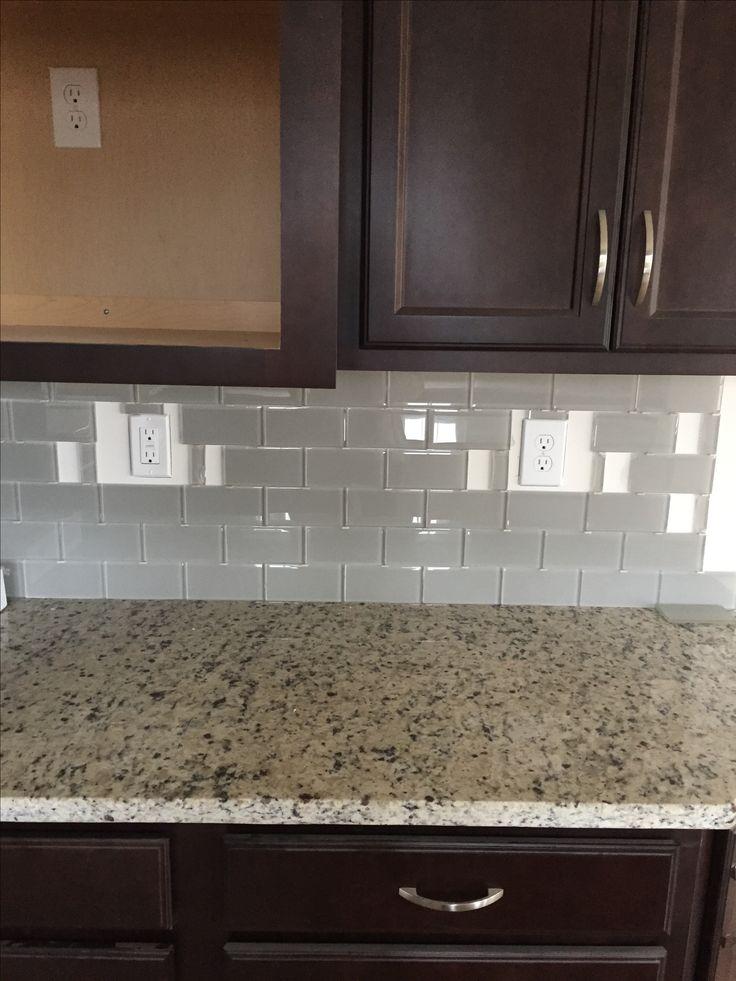 Espresso Cabinets And Crema Pearl Granite And Off White Subway Glass Tiles Kitchen Backsplash