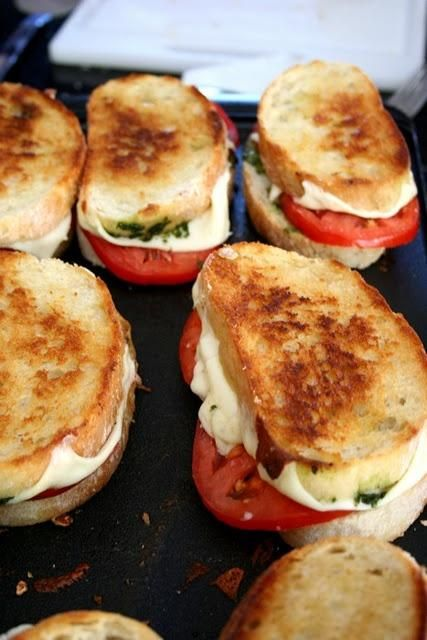 french bread, mozzarella cheese, tomato, pesto + drizzled olive oil... Caprese sandwiches!