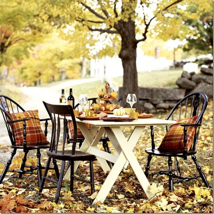 Beautiful use of old castoff furniture for an outdoor seating/eating spot