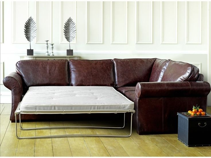 Furniture : Classic corner brown leather sofa bed design ideas with white bed portable and wooden flooring also white wooden wall ideas picture - a part of Contemporary Elegant leather Sofas for Your Living Space Design Plans