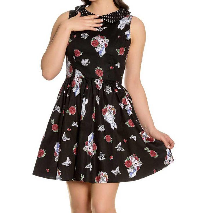 Hell Bunny. Een zwarte fifties jurk met konijnen en rozen print. De jurk heeft een Peter Pan kraag in zwart/wit met polkadot stippen and op de achterkant zit een uitgesneden hart detail.