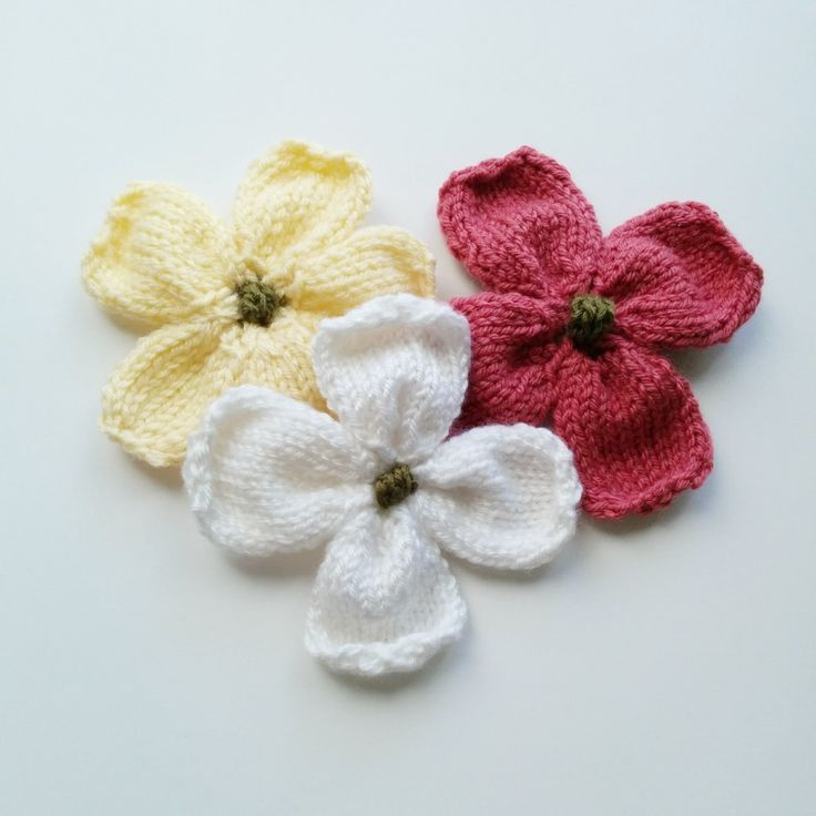 I have finally finished a pattern for knitted dogwood blossoms that I've been working on for the past week or so. This knitted flower is great for brooches, additions to hats and scarves or use it in place of a bow on gift boxes!