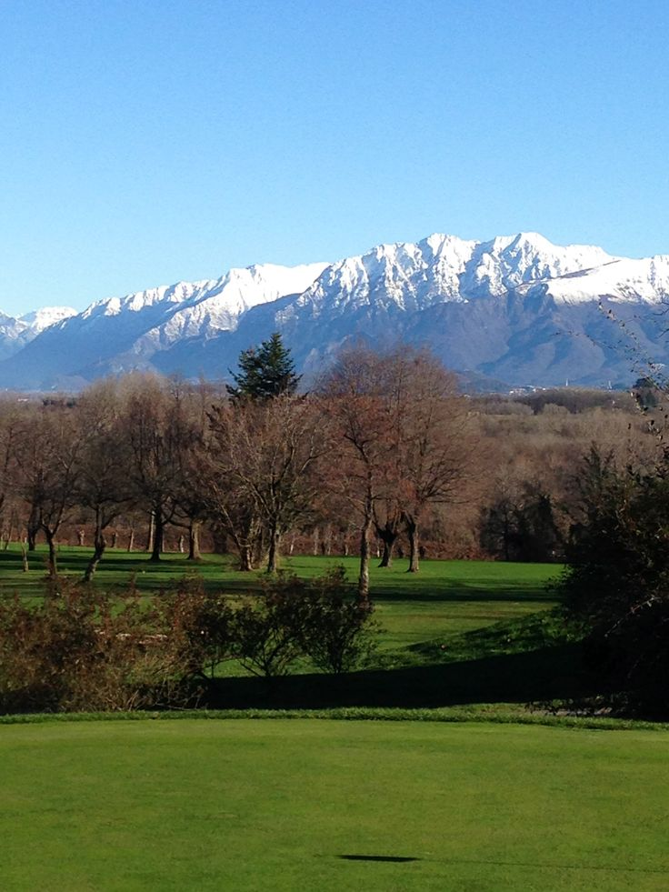 The course and the view on Giulian Alps in northern east Italy. Golf Club Udine, Fagagna - Italy