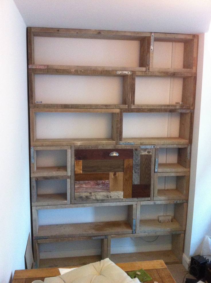 Bookcase/desk made from old scaffold boards and off cuts of flooring. Door folds down to make a desk