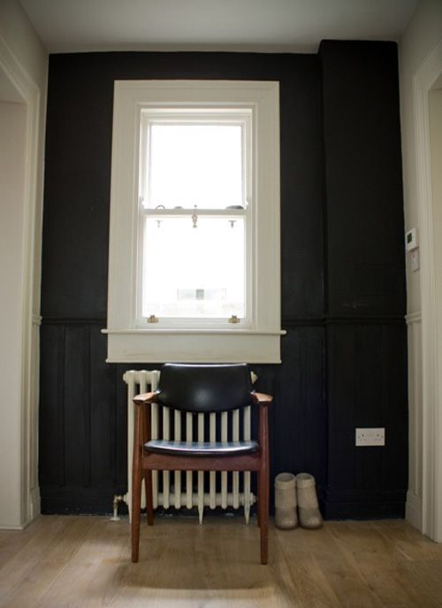 Black hallway http://www.myhomerocks.com/2012/03/beautiful-laid-back-home-design-by-ekaterina-voronova/