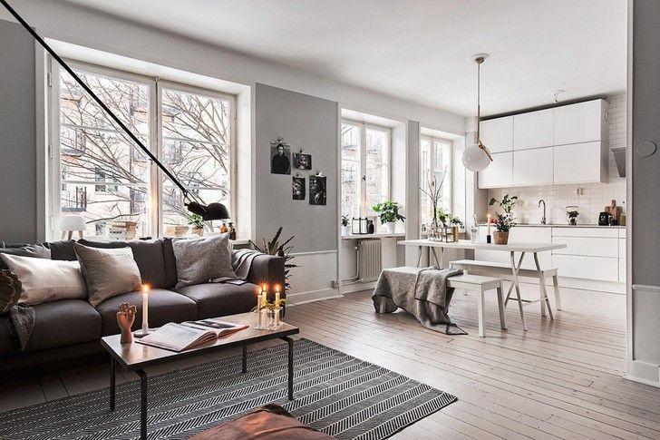 Еще один пример скандинавского интерьера, основанного на холодных бело-серых тонах. В этот раз у нас открытая планировка на площади 52 кв. м, лишь спальня отделена, как это в последнее время стало модно, стеклянной перегородкой от общего пространства. И в целом,все очень «по-северному»: только необходимая мебель, белая кухня, фотографии и постерыв рамках на стене, натуральный текстиль. …