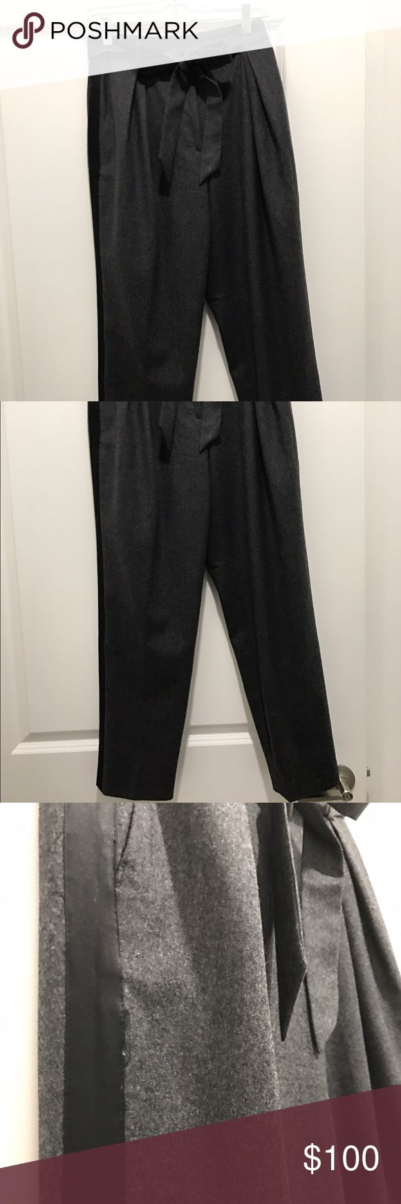J.Crew Collection tie waist wool tuxedo pants High waisted 100% wool tuxedo pant. Tie belt at waist. Black silk tuxedo strip down legs. Front pleating for a flattering fit. Color is dark charcoal grey with black strip on each side of leg. Pant length hits just above the ankle. J. Crew Pants Trousers