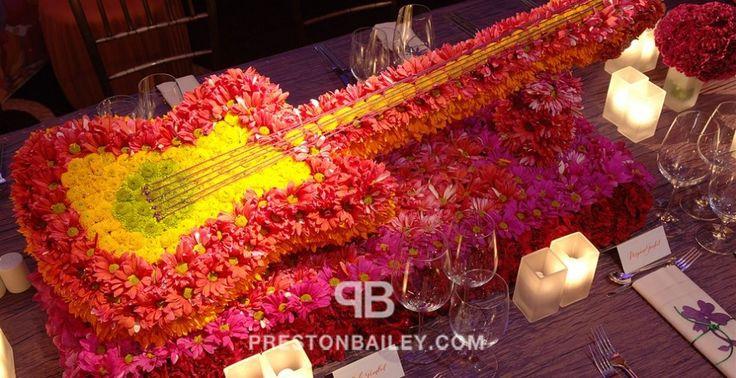 centerpiece entertaining flowers long table low centerpieces mum table setting color pink color violet color yellow