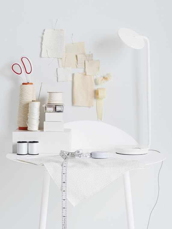 Pixo LED Table Lamp in White. Available in eight playful colors, Pixo is infinitely adjustable and has a built-in USB port for charging your phone.
