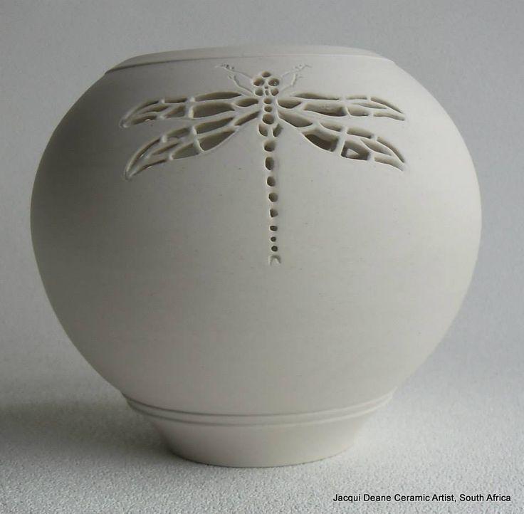 I am a potter who specialises in hand carved porcelain.   https://www.facebook.com/pages/Jacqui-Deane-Ceramic-Artist/490960717632440