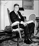 Little Known Facts About JFK: Kennedy tried many strategies to avoid back strain – sleeping with a board under his mattress, wearing a left shoe lift to compensate for a disparity in the length of his legs. Dr. Janet Travell, suggested using a rocking chair to provide gentle exercise for his lower back muscles. He purchased a simple Appalachian oak rocker and took it with him on Air Force One, to Camp David, in Hyannis Port, and the Kennedy house in Palm Beach.