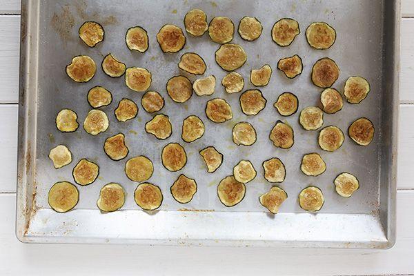 Curried Zucchini Crisps -  •2 medium zucchini, sliced into thin rounds •2 teaspoons olive oil •1/2 cup Panko bread crumbs •Curry powder •Salt •Pepper 375F 40-45 min