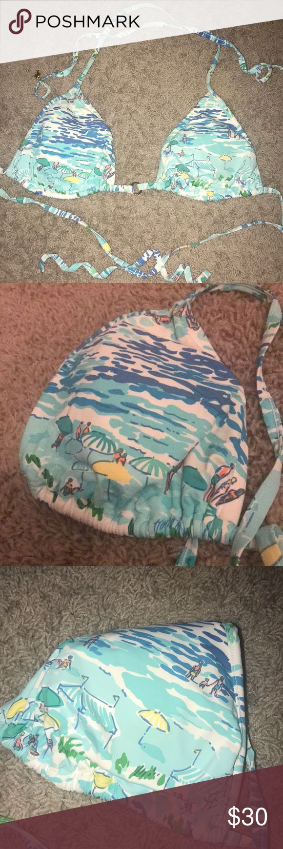 Lilly Pulitzer Triangle Bikini Top Has a beach scene on it i don't know the name for the pattern Has two little charms at the ends of the ties and a gold ring in the center of the two cups Size large I wear a 32DD and this fits me i just tie the straps extra tight to make it fit around me better and the large size is good for coverage!  Worn but in near perfect condition I have the bottoms too and can list Lilly Pulitzer Swim Bikinis