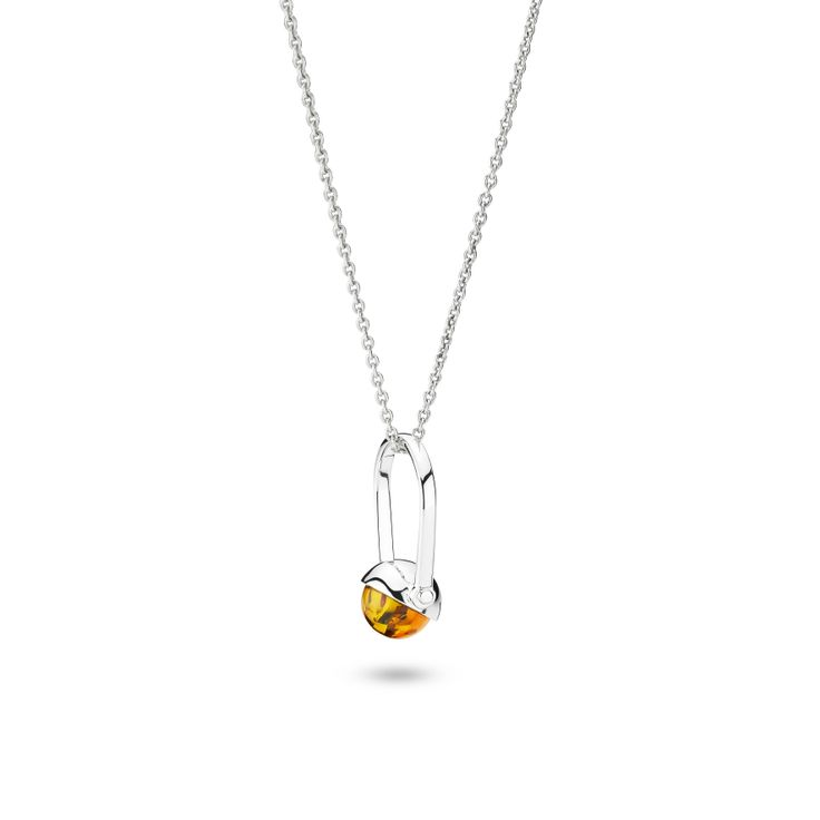 House of Amber by Louise Sigvardt - Silver ring with amber used as pendant.