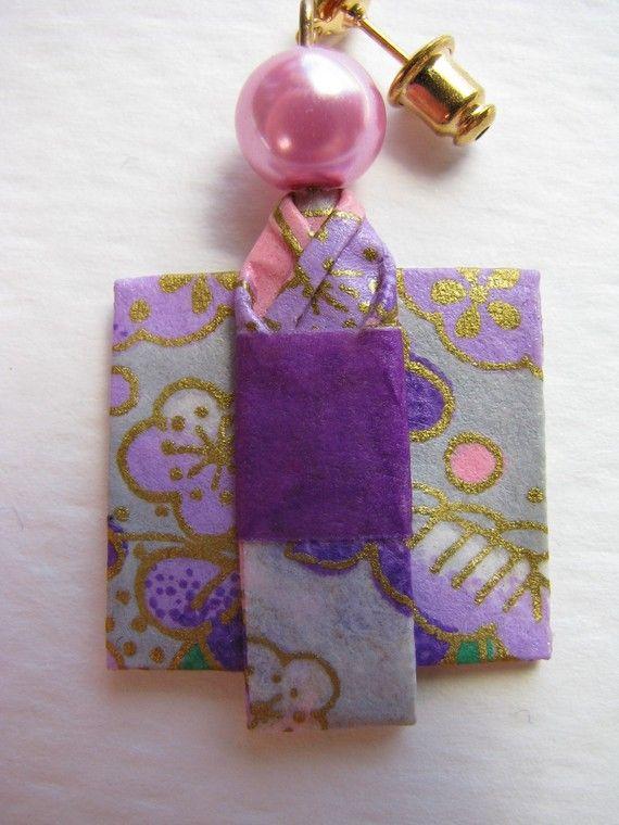 An original idea!  Origami doll turned into an earring -- so cute!