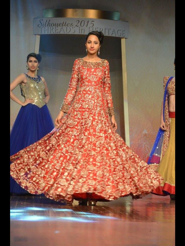 Red gown on net with resham and kasab work all over with gold stones only at manish reshamwala fashion studio,9879568040