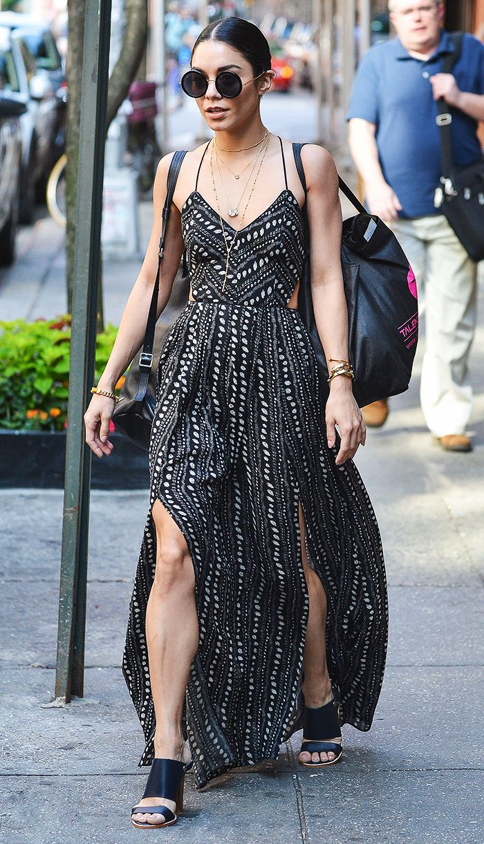 Vanessa Hudgens in a printed maxi dress,  mules, and round sunglasses