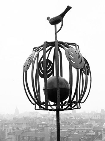 Weathervane on the Glasgow School of Art designed by Charles Rennie Mackintosh. He won the architectural commission in 1897. Photo taken by Eric De Mare ca.1960