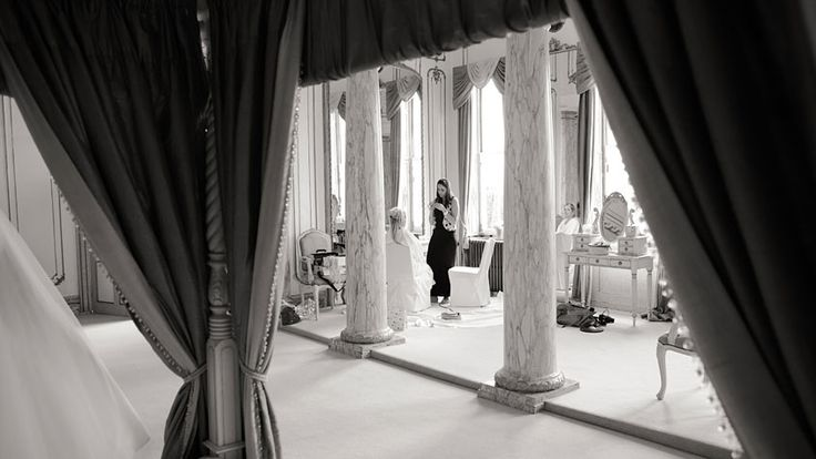 Bride getting ready in the Rococco suite of Gosfield Hall