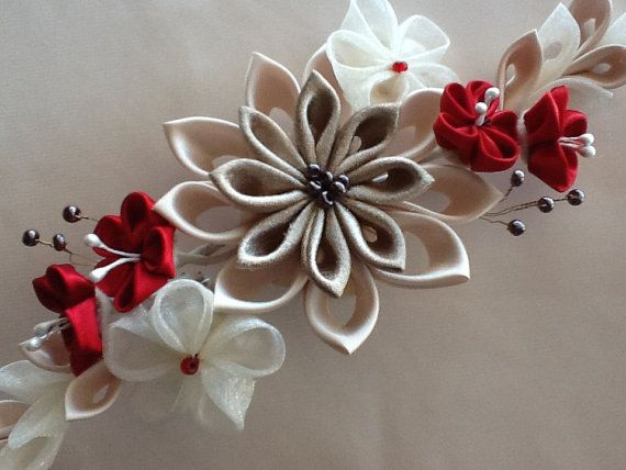 This stylish, elegant hair piece features beautiful handmade Kanzashi flowers embellished with mauve & red glass beads.