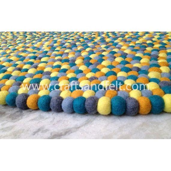 Yellow felt ball rug from Nepal