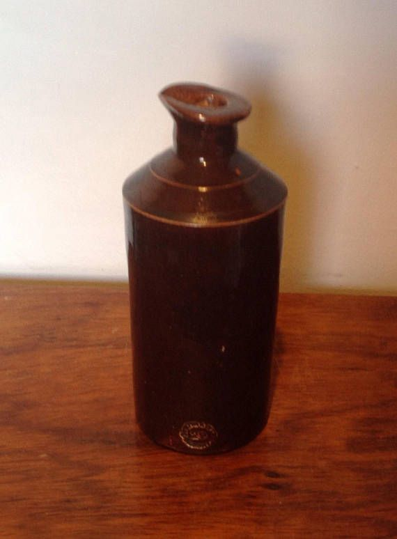 A nice example of a Stoneware saltglaze ink bottle made by Doulton & Co. of Lambeth in the late 1800s Bottle has a pouring lip and good clear stamp..Doulton & Co. Lambeth , with a number 29 inside the circle. The remains of the cork stopper are trapped inside the bottle. Measures 6.2