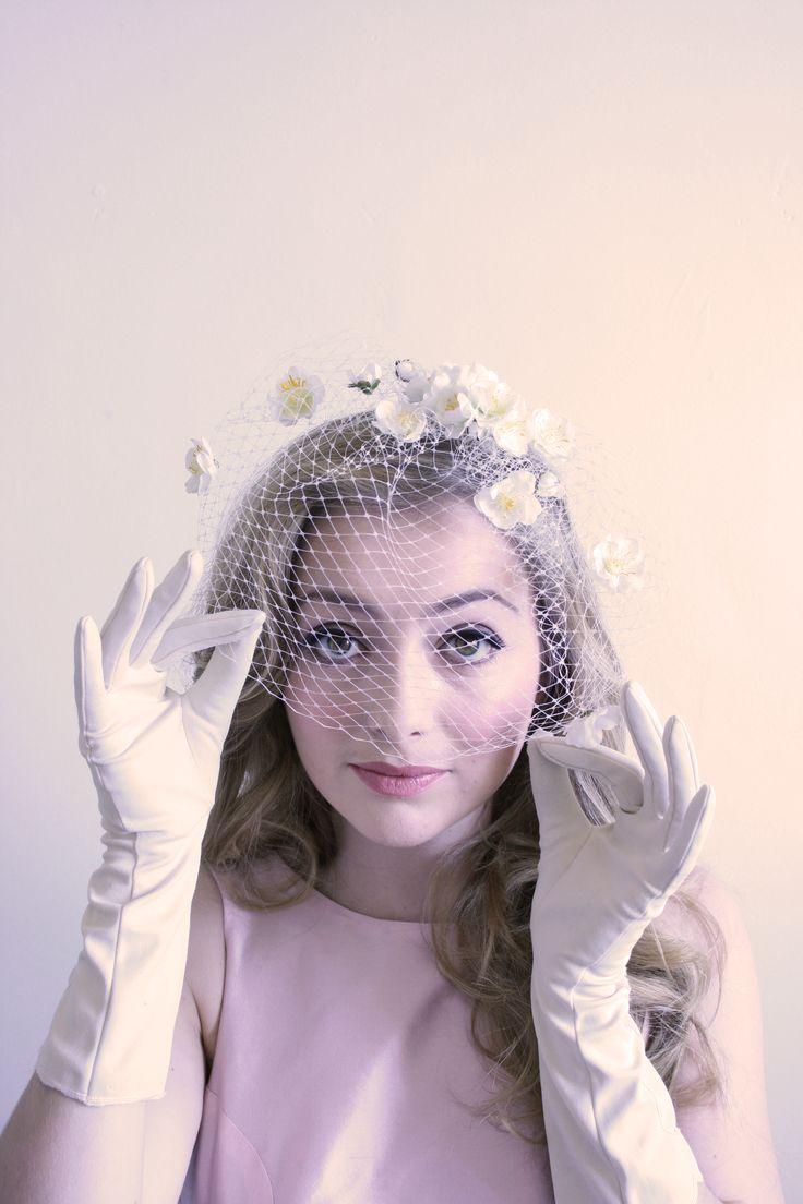 Natalie Chan 'Le Bon Marche' petite blossoms hand sewn onto a birdcage veil