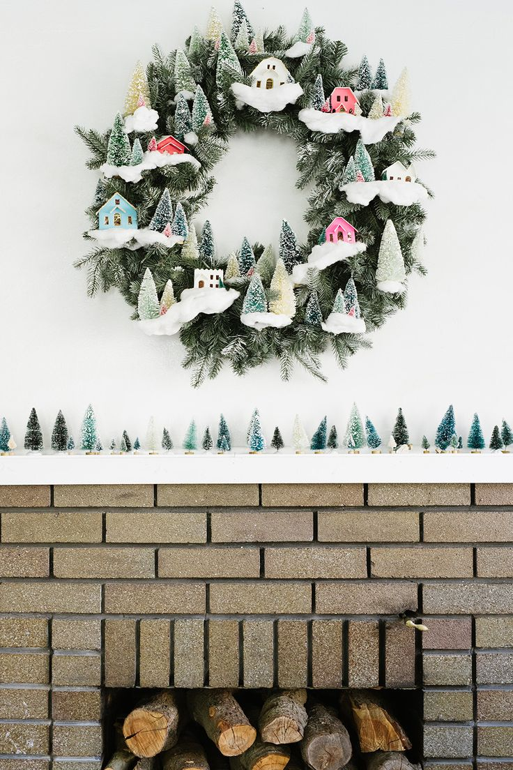 Were loving this DIY wreath and mantle. Nothing says festive like tiny flocked evergreens! Plus